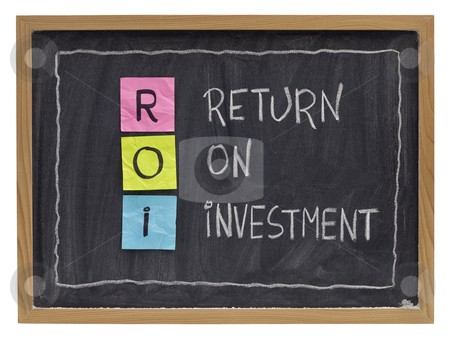 Return on investment concept stock photo, ROI - return on investment acronym explained with color sticky notes and white chalk handwriting on blackboard by Marek Uliasz