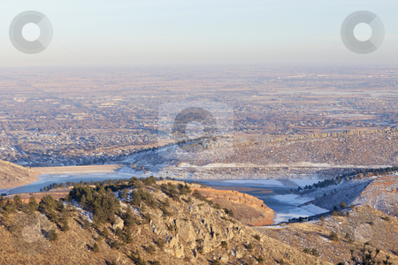 Winter afternoon in Colorado Front Range stock photo, typical hazy winter afternoon over Fort Collins, Colorado with frozen Horsetooth Reservoir, some snow, clear sky, but with a brown layer of dust and aerosols in the air by Marek Uliasz