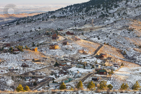 Home in Rocky Mountains, Colorado stock photo, residential house on slopes of Rocky Mountains near Fort Collins, Colorado, winter afternoon scenery by Marek Uliasz