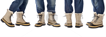 Blue jeans and snow boots stock photo, man legs in blue jeans and heavy snow boots, four poses isolated on white by Marek Uliasz