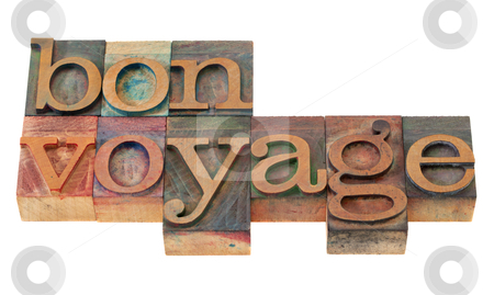 Bon voyage - phrase in letterpress type stock photo, travel concept - bon voyage phrase in vintage wooden letterpress printing blocks, stained by color inks, isolated on white by Marek Uliasz
