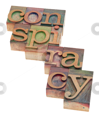 Conspiracy word in letterpress type stock photo, conspiracy word in vintage wood letterpress printing blocks, stained by color inks, isolated on white by Marek Uliasz