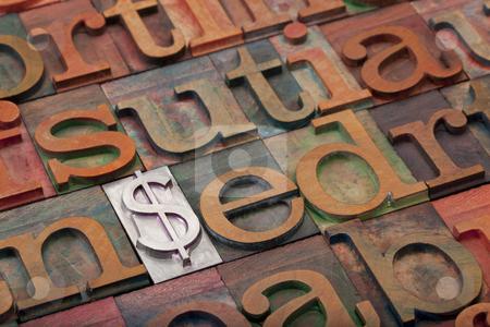 Dollar sign in letterpress type stock photo, metal dollar sign among vintage wooden letterpress printing blocks - financial concept by Marek Uliasz