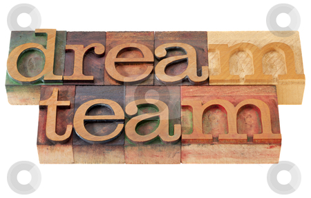 Dream team in letterpress type stock photo, teamwork concept - dream team words in vintage wooden letterpress printing blocks, stained by color inks, isolated on white by Marek Uliasz