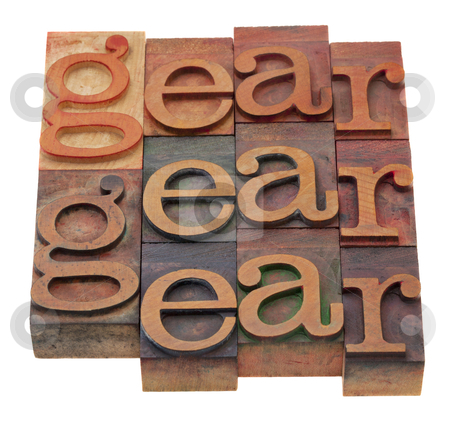 Gear - word in letterpress type stock photo, gear - word abstract in vintage wooden letterpress printing blocks, stained by color inks, isolated on white by Marek Uliasz