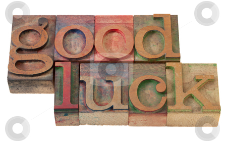 Good luck- phrase in letterpress type stock photo, good luck- phrase  in vintage wooden letterpress printing blocks, stained with color inks, isolated on white by Marek Uliasz
