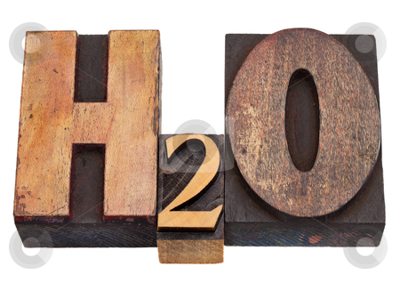 Water chemical symbol stock photo, H2O - water chemical symbol in vintage wood letterpress printing blocks, stained by color inks, isolated on white by Marek Uliasz