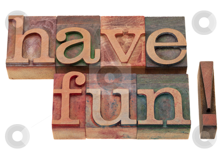 Have fun phrase in letterpress type stock photo, have fun exclamation in vintage wooden letterpress printing blocks, stained by color inks, isolated on white by Marek Uliasz