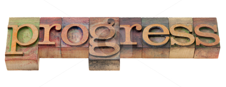 Progress - word in old letterpress type stock photo, progress - word in vintage wooden letterpress printing blocks, stained by color inks, isolated on white by Marek Uliasz