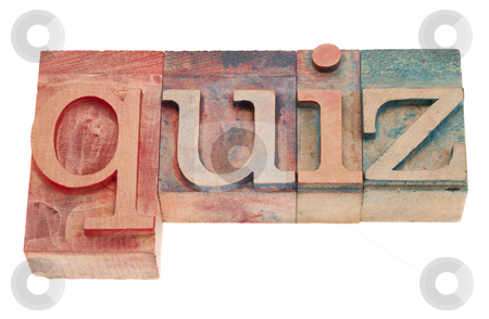 Quiz word in wood letterpress type stock photo, quiz word in vintage wood letterpress printing blocks, stained by color inks, isolated on white by Marek Uliasz