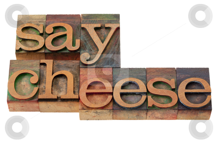 Say cheese - phrase in letterpress type stock photo, photography concept - say cheese phrase in vintage wooden letterpress printing blocks, stained by color inks, isolated on white by Marek Uliasz