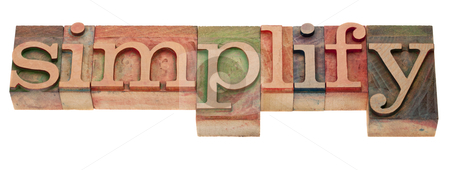 Simplify - word in letterpress type stock photo, simplify- word in vintage wooden letterpress printing blocks, stained by color inks, isolated on white by Marek Uliasz