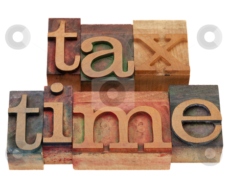 Tax time in letterpress type stock photo, tax time words in vintage wooden letterpress printing blocks, stained by color inks, isolated on white by Marek Uliasz