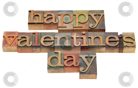Happy Valentine day stock photo, happy Valentine day wishes in vintage wooden letterpress printing blocks, stained by color inks, isolated on white by Marek Uliasz