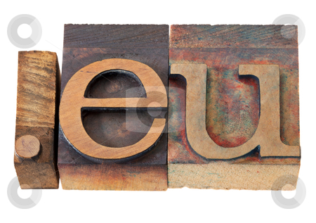 Internet domain for European Union  stock photo, dot eu - internet domain for European Union in vintage wooden letterpress printing blocks, stained by color inks, isolated on white by Marek Uliasz