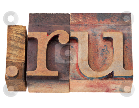 Internet domain for Russia stock photo, dot ru - internet domain for Russia in vintage wooden letterpress printing blocks, stained by color inks, isolated on white by Marek Uliasz