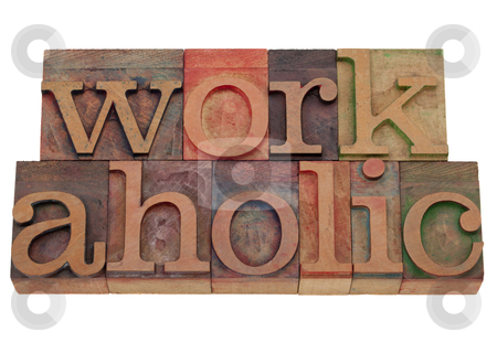 Workaholic word in letterpress type stock photo, a compulsive worker concept, workaholic word in vintage wooden letterpress printing blocks, stained by color inks, isolated on white by Marek Uliasz