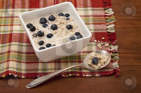 Muesli cereal breakfast stock photo, muesli cereal breakfast with blueberries and soy milk by Marek Uliasz