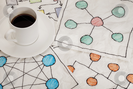 Network schematics - napkin doodle stock photo, different network schematics sketched on white napkins with espresso coffee cup by Marek Uliasz