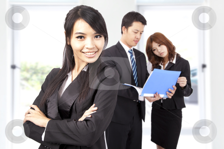 Young and smiling Business woman in an office  stock photo, Young and smiling Business woman in an office  by tomwang