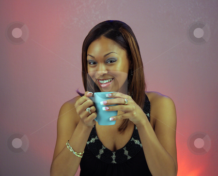 Beautiful Teen Girl with Coffee (1) stock photo, Close-up of a lovely teen with a captivating smile, holding a cup of coffee or hot tea. by Carl Stewart