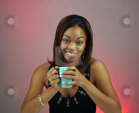 Beautiful Teen Girl with Coffee (2) stock photo, Close-up of a lovely teen with a captivating smile, holding a cup of coffee or hot tea. by Carl Stewart