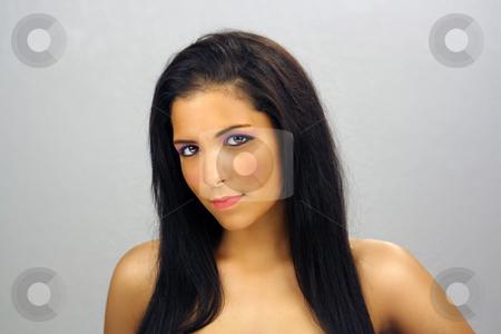 Beautiful Teen Latina Headshot (5) stock photo, Close-up of a lovely shy teenage Latina with long, luscious black hair. by Carl Stewart