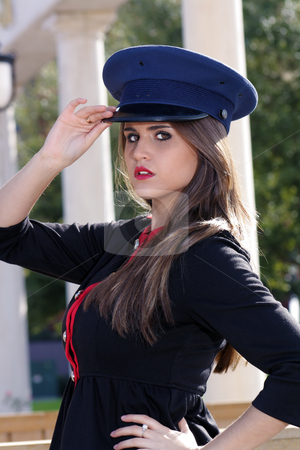 Beautiful Brunette Guard (8) stock photo, Close-up shot of a beautiful young brunette wearing a stylized costume that's remeniscent of the old British Guard, outdoors on a bright, sunny day. by Carl Stewart