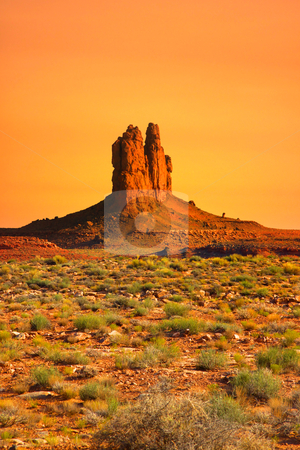 Monument valley stock photo, Red rock formations in scenic monument valley with evening sky by Sreedhar Yedlapati