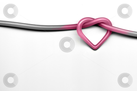 Heart knot stock photo, pink heart knot on white background - valentine day concept by Christophe Rolland