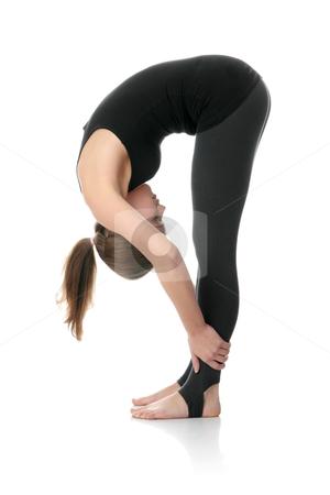 Beautiful young woman doing exercise stock photo, Beautiful young woman doing exercise , isolated  by Piotr_Marcinski