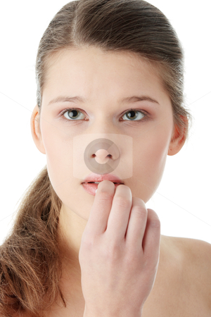 Removeing her make-up stock photo, Young woman using a cotton pad to remove her make-up, isolated on white by Piotr_Marcinski