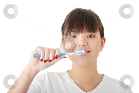 Washing her teeth stock photo, Young beautiful woman washing her teeth with blue brush, isolated on white background  by Piotr_Marcinski