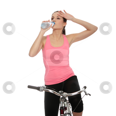 Attractive brunette woman with bike stock photo, Attractive brunette woman with bike drinking water. over white background  by Piotr_Marcinski