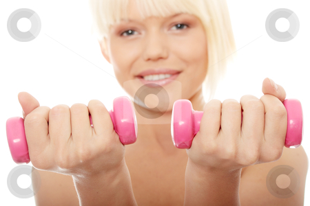 Exercising stock photo, Young topless woman exercising with dumb bells by Piotr_Marcinski