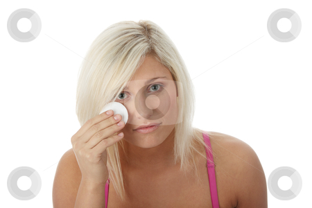 Young woman using a cotton pad stock photo, Young woman using a cotton pad to remove her make-up, isolated on white   by Piotr_Marcinski