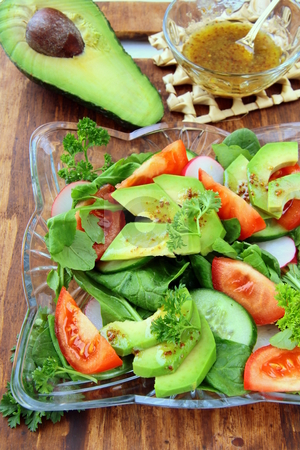 Salad with tomato and avocado on a crystal  plate stock photo, salad with tomato and avocado on a crystal  plate by Olga Kriger