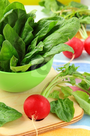 Fresh spinach in a green bowl on a cutting board  stock photo, Fresh spinach in a green bowl on a cutting board  by Olga Kriger