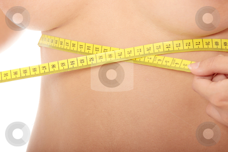 Woman measuring her waist stock photo, Naked belly of sexy, fit, young woman measuring her waist by Piotr_Marcinski