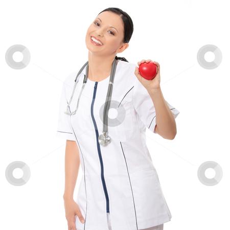 Female doctor stock photo, Female doctor with sthetoscope holding heart by Piotr_Marcinski