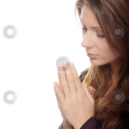 Pray stock photo, Closeup portrait of a young caucasian woman praying  by Piotr_Marcinski