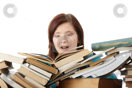 Young woman behind books stock photo, Young woman behind books, isolated on white background by Piotr_Marcinski