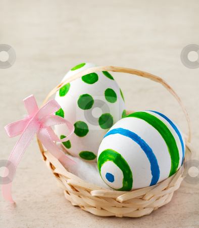 Easter eggs stock photo, Painted easter eggs in a basket with ribbon by borojoint