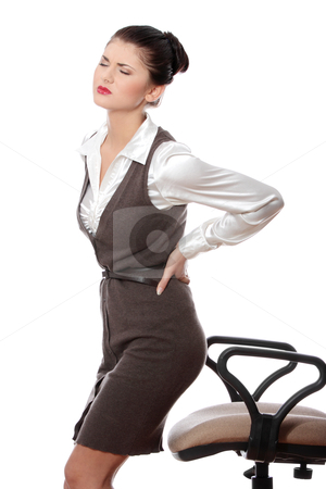 Back pain stock photo, Business woman with back pain after long work on chair. Isolated on white background by Piotr_Marcinski