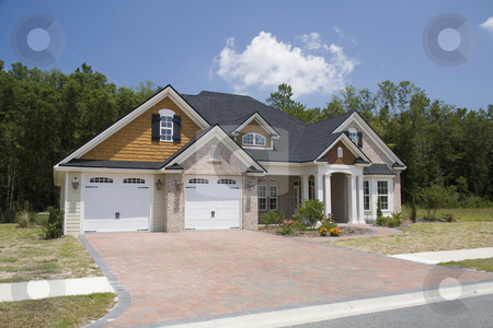 New upscale home stock photo, upscale home with brick, vinyl and shake siding with brick paver driveway by Lee Barnwell