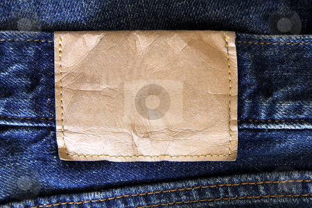 Blank Jean Label stock photo, A blank label on a pair of jeans. by Chris Hill