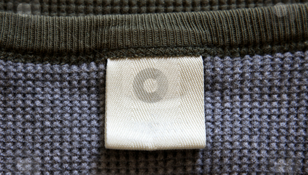 Shirt Label stock photo, A blank label on a shirt.  by Chris Hill