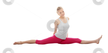 Young woman makes exercise stock photo, Young woman makes exercise isolated on white by Piotr_Marcinski