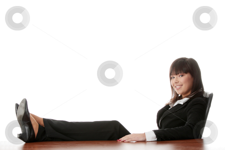 Beautiful business lady stock photo, Young beautiful business lady having a rest at the working place. Isolated.  by Piotr_Marcinski