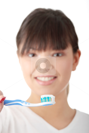 Teeth stock photo, Young beautiful woman washing her teeth with blue brush, isolated on white background - focus on brush by Piotr_Marcinski